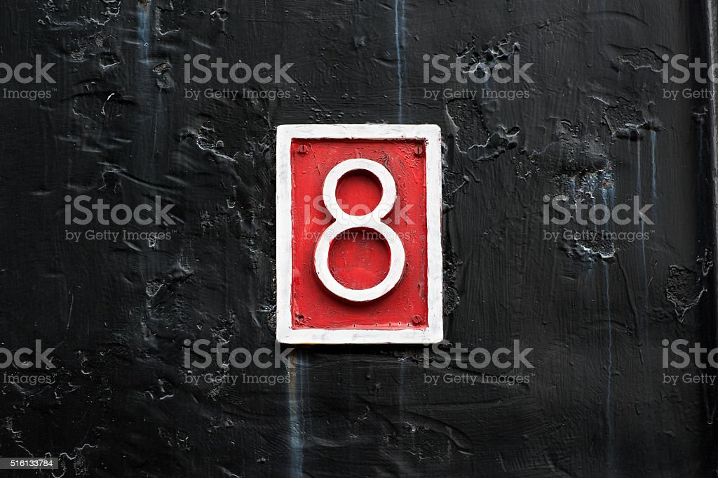 Close up of number 8 on steel background stock photo