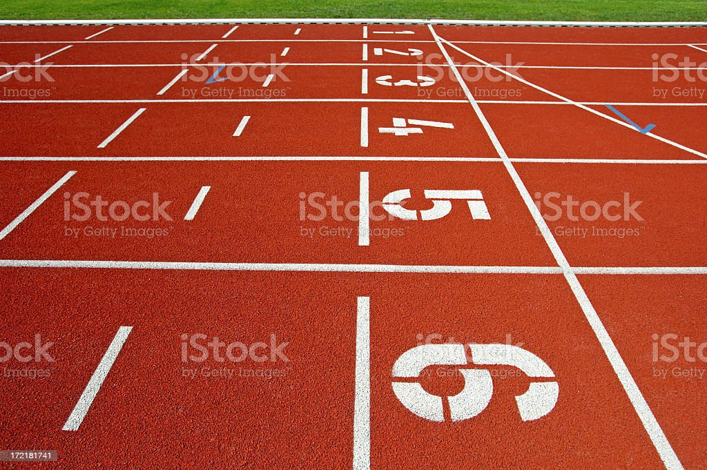 Close up of numbered lanes on athletic track royalty-free stock photo