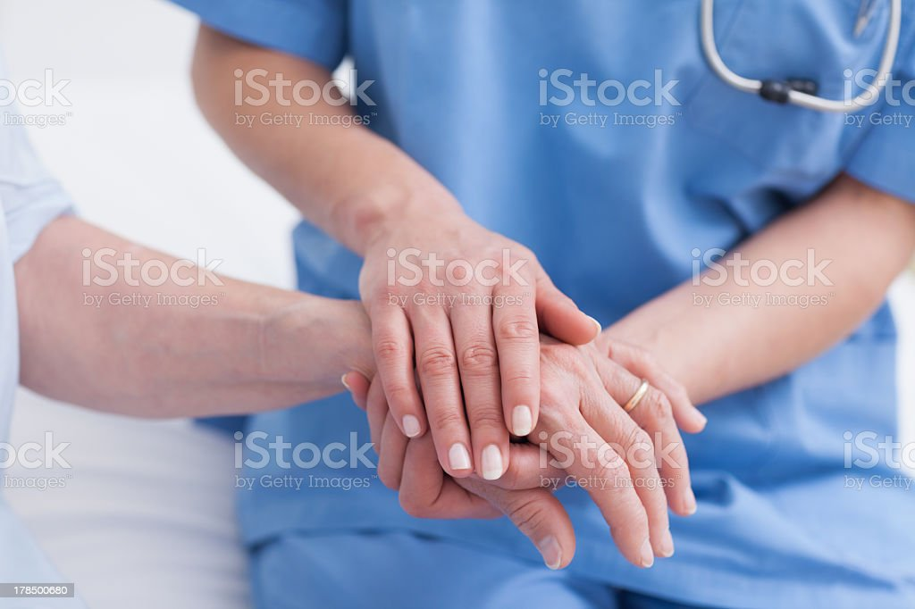 Close up of nurse touching the patient hand royalty-free stock photo