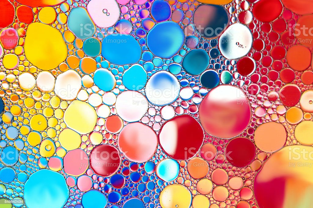 Close up of oil drop on water surface. stock photo