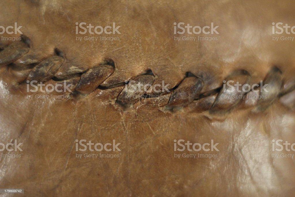 Close up of old sewn leather baseball seam stock photo