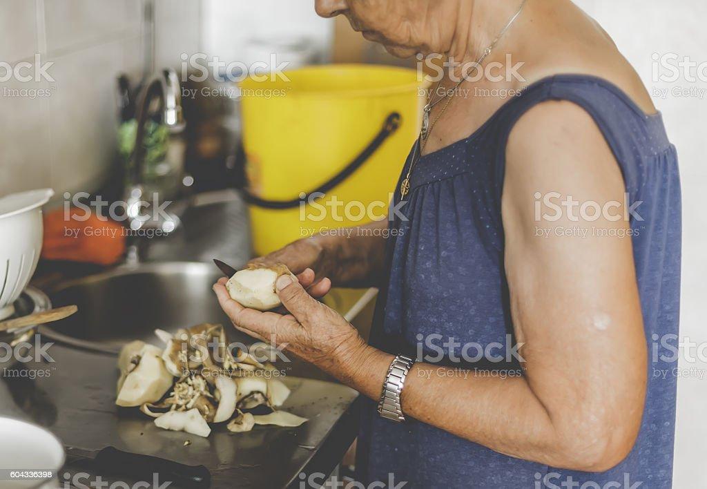 Close up of Old Woman Peeling Potatoes. Selective focus foto royalty-free