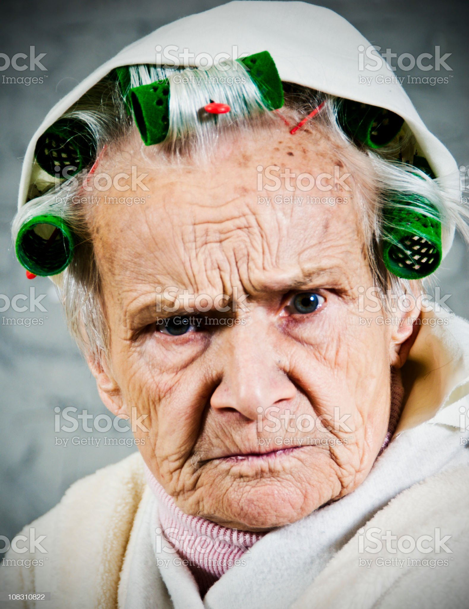 Close up of old Women with curlers and dressing gown royalty-free stock photo