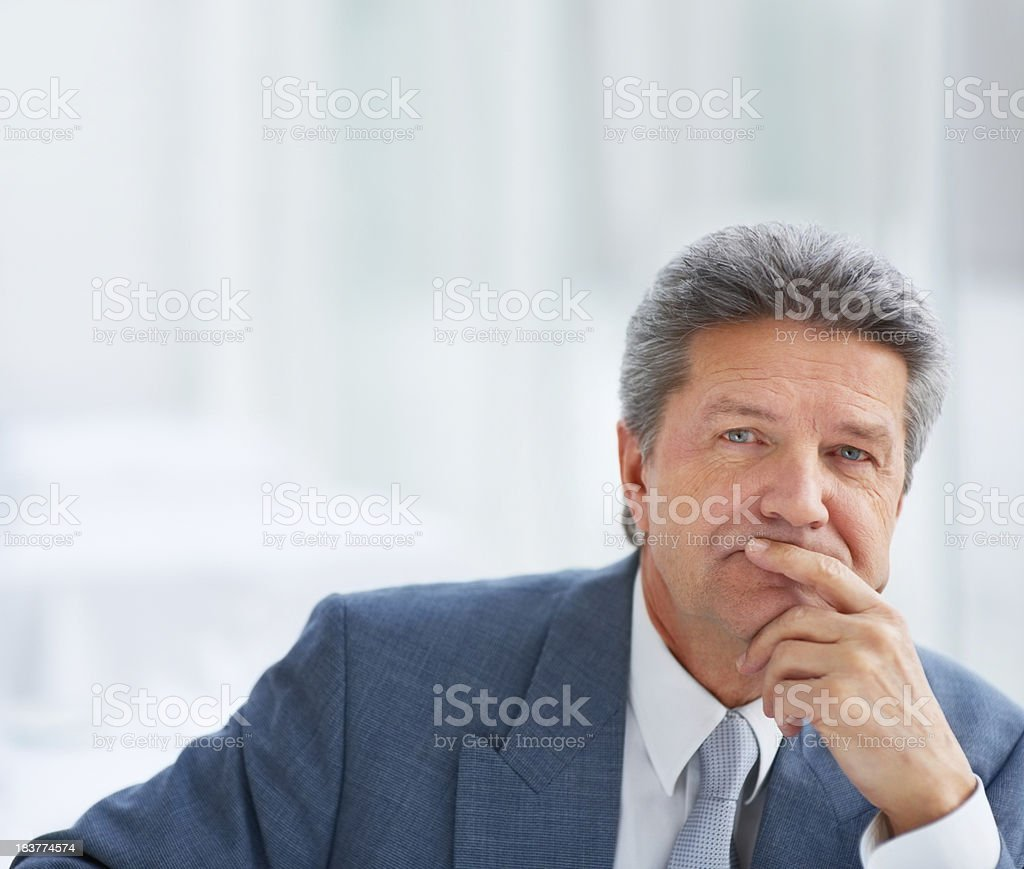 Close up of older businessman in deep thought stock photo