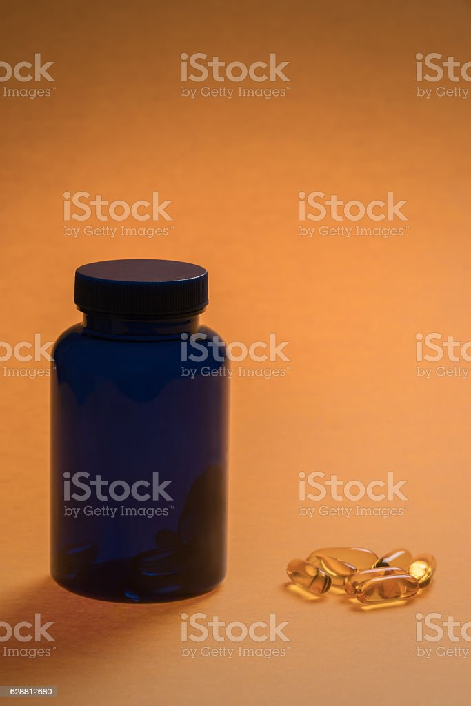 Close up of omega 3 capsules and bottle stock photo