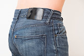 Close up of one man back  wearing jeans