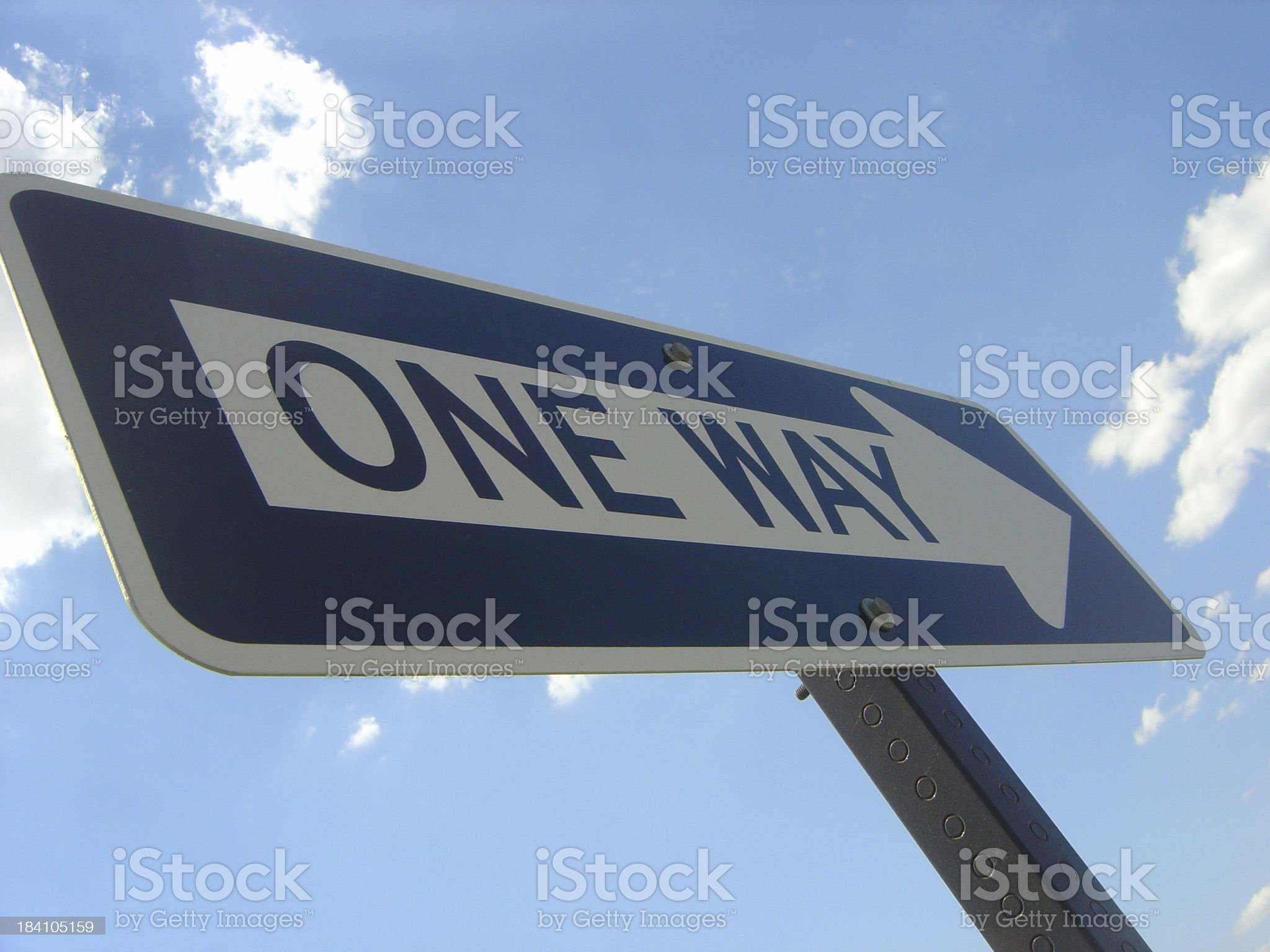 Close up Of One Way Sign Pointing Towards The Sky royalty-free stock photo