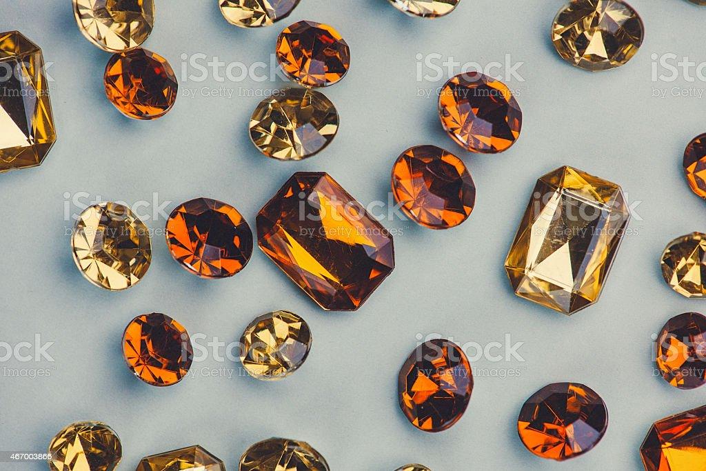 Close up of orange rhinestones gems stock photo