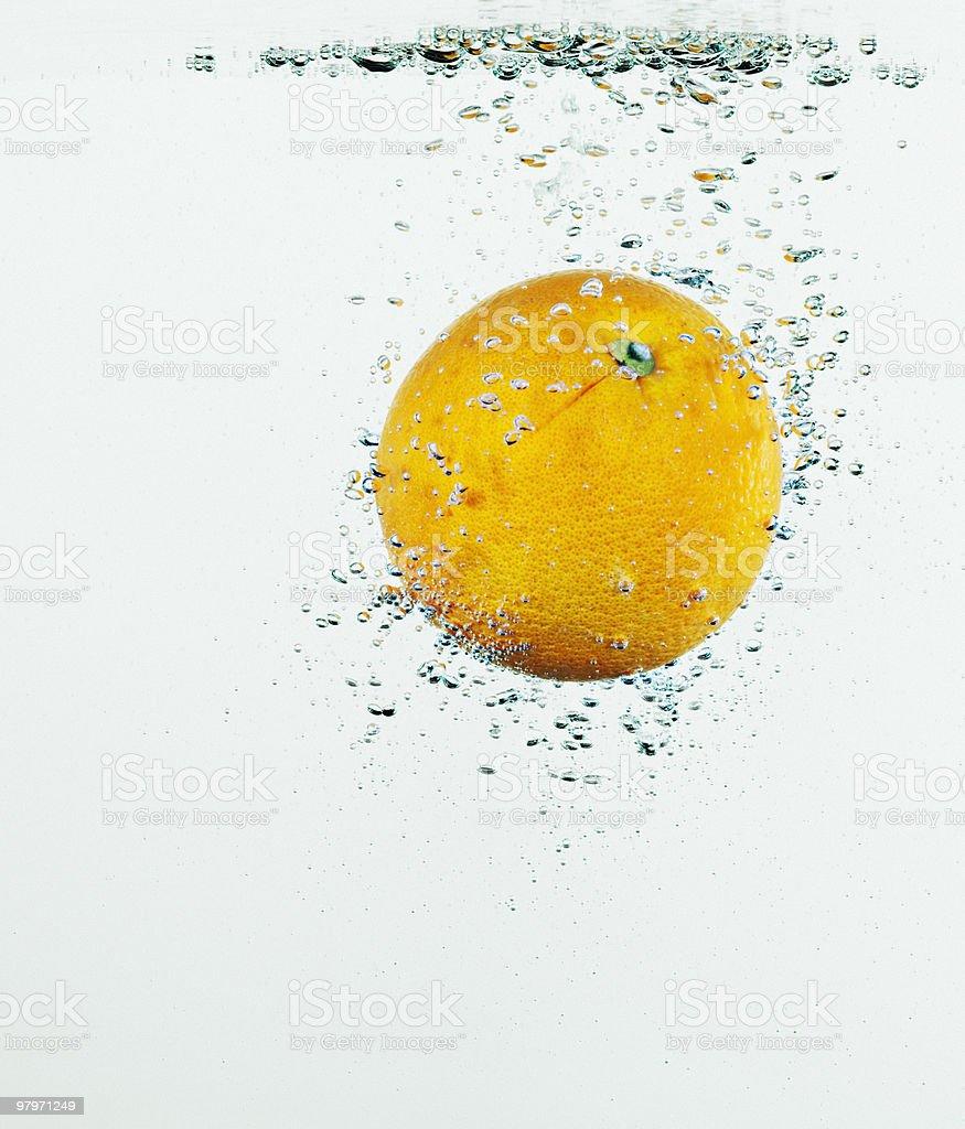 Close up of orange splashing in water royalty-free stock photo