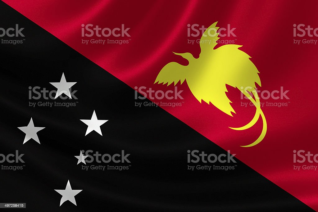 Close Up of Papua New Guinea's Flag on satin textile royalty-free stock photo