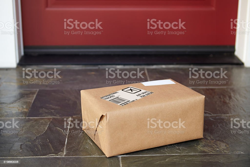 Close Up Of Parcel Delivery Outside Front Door stock photo