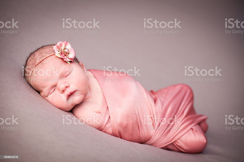 Close Up of Peaceful Newborn Baby Girl Swaddled in Blanket royalty-free stock photo