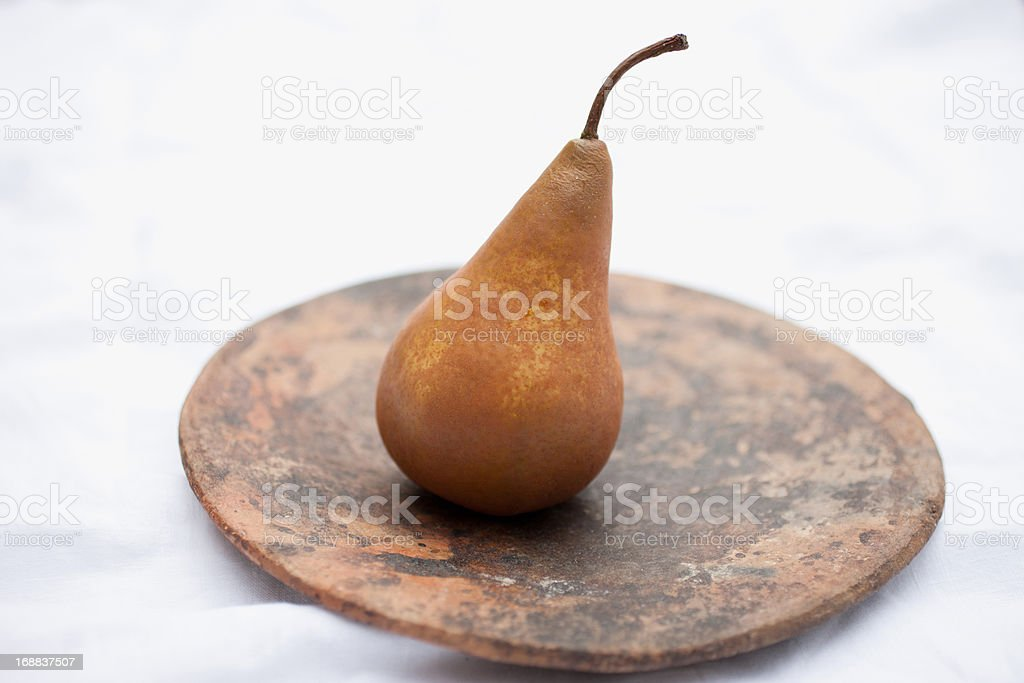 Close up of pears on wooden circle royalty-free stock photo