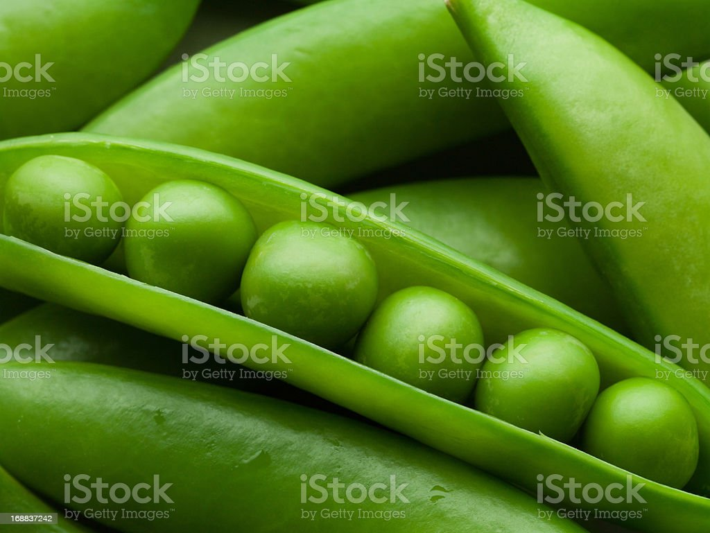 Close up of peas in pea pod stock photo