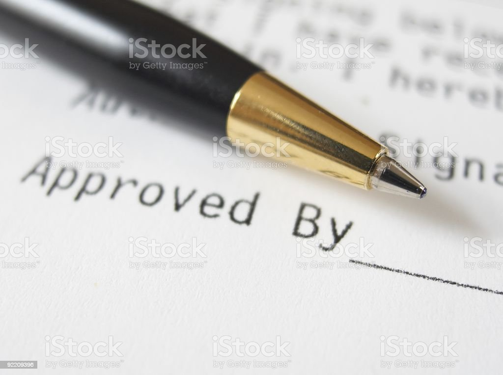 Close up of pen and contract signature line stock photo