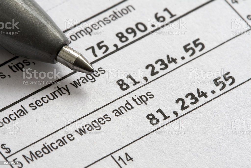 Close up of pen tip on tax form stock photo