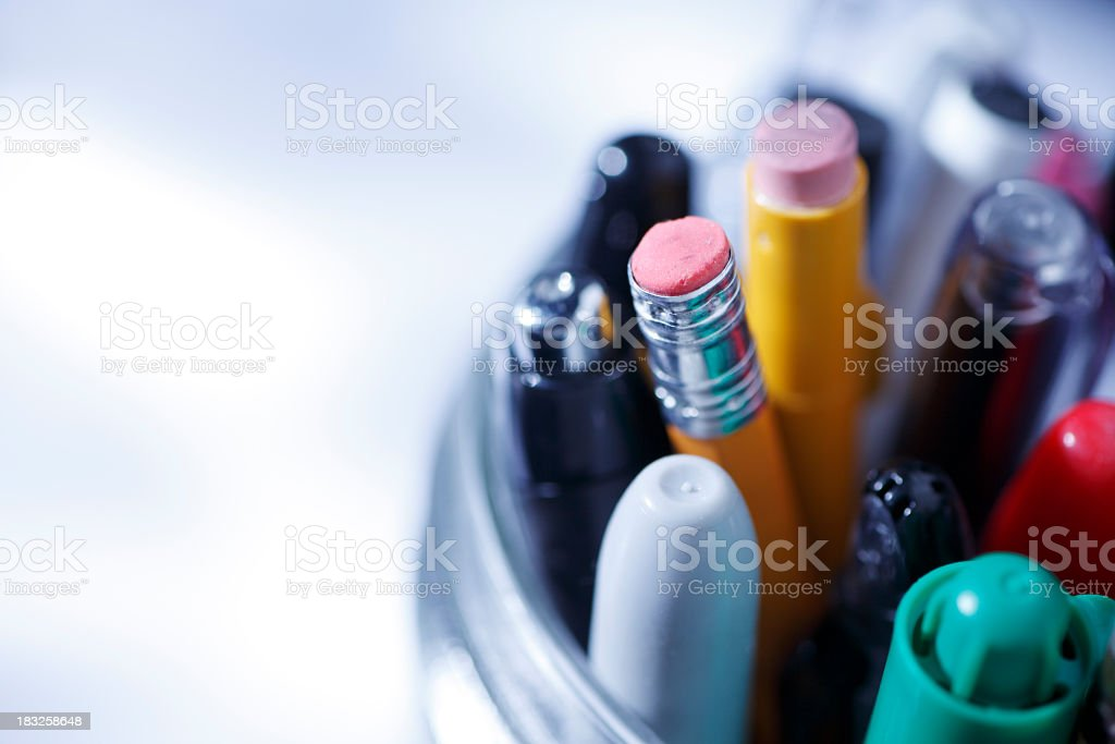 Close up of pens and pencils in a jar stock photo