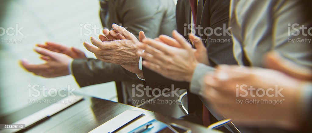 Close up of people in suits clapping stock photo