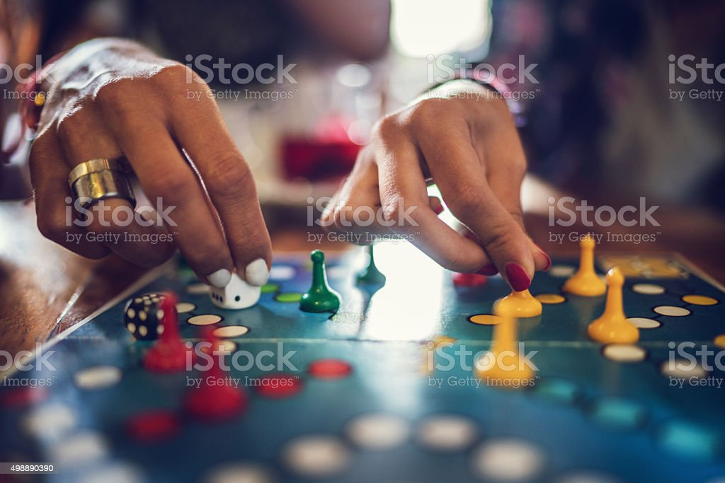 Close up of people playing cross and circle game. stock photo