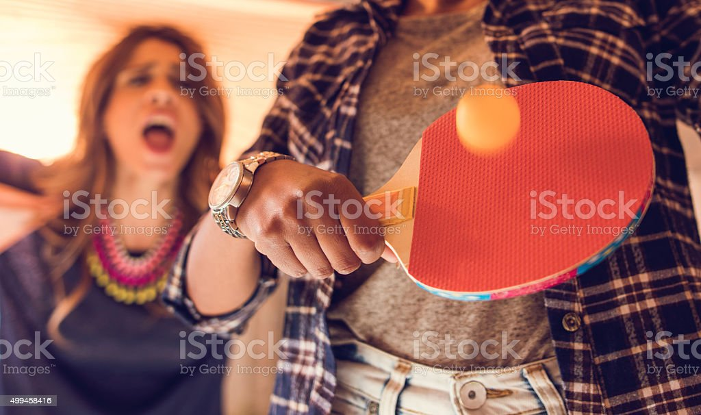 Close up of people playing table tennis. stock photo