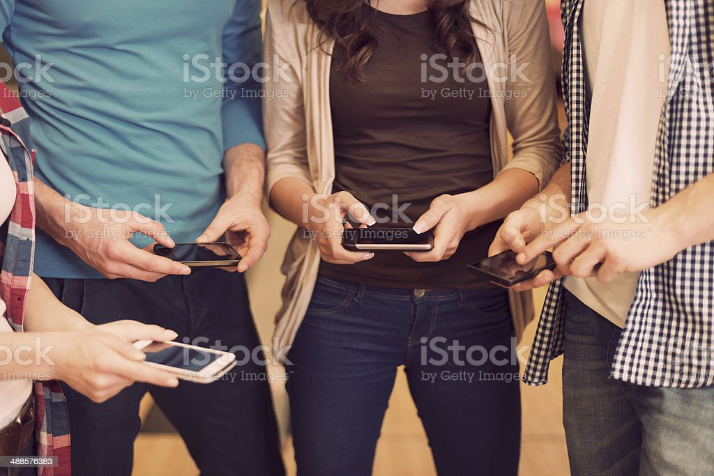 Close up of people with contemporary mobile phones stock photo