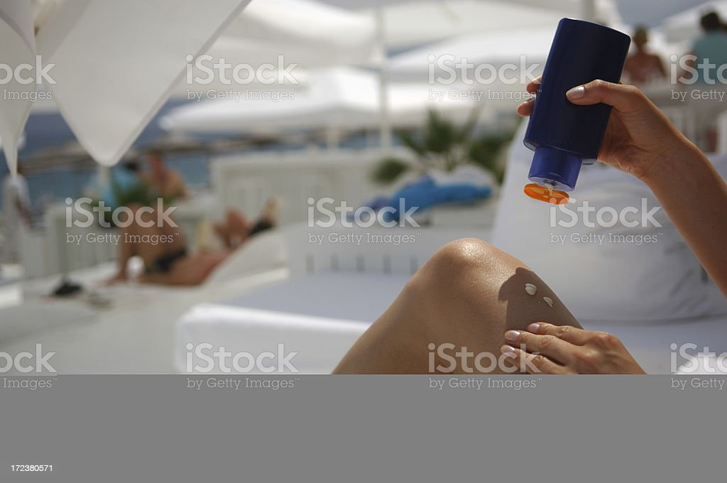 Close up of person applying sunscreen at a resort royalty-free stock photo