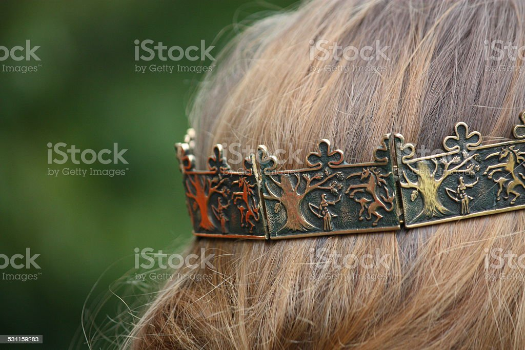 Close up of person with medieval crown stock photo