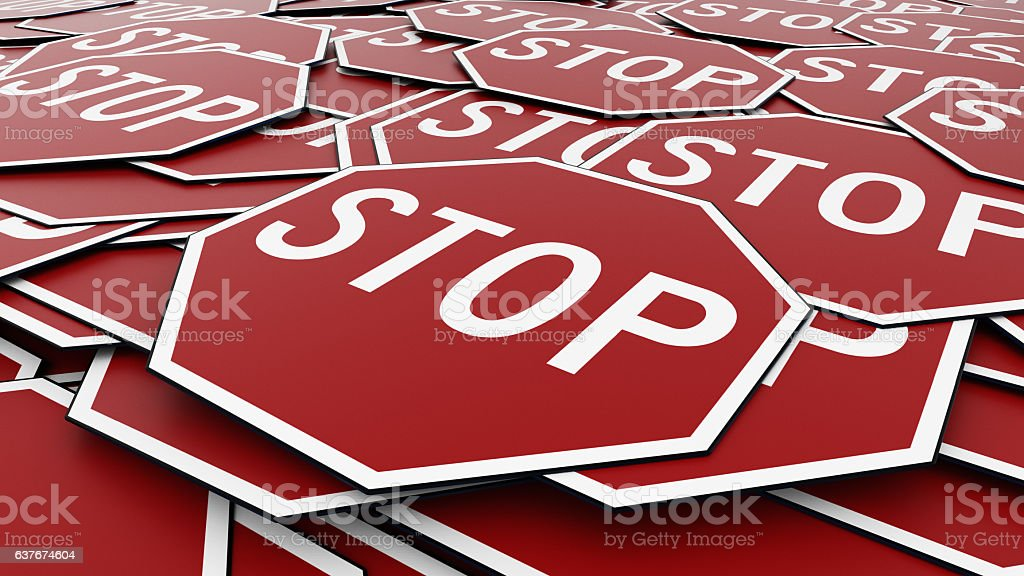 Close Up of Pile of Octagonal Stop Signs stock photo