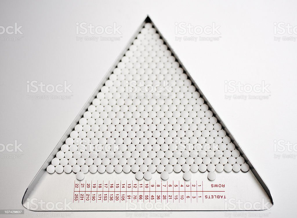 Close up of pills in sorting tray royalty-free stock photo