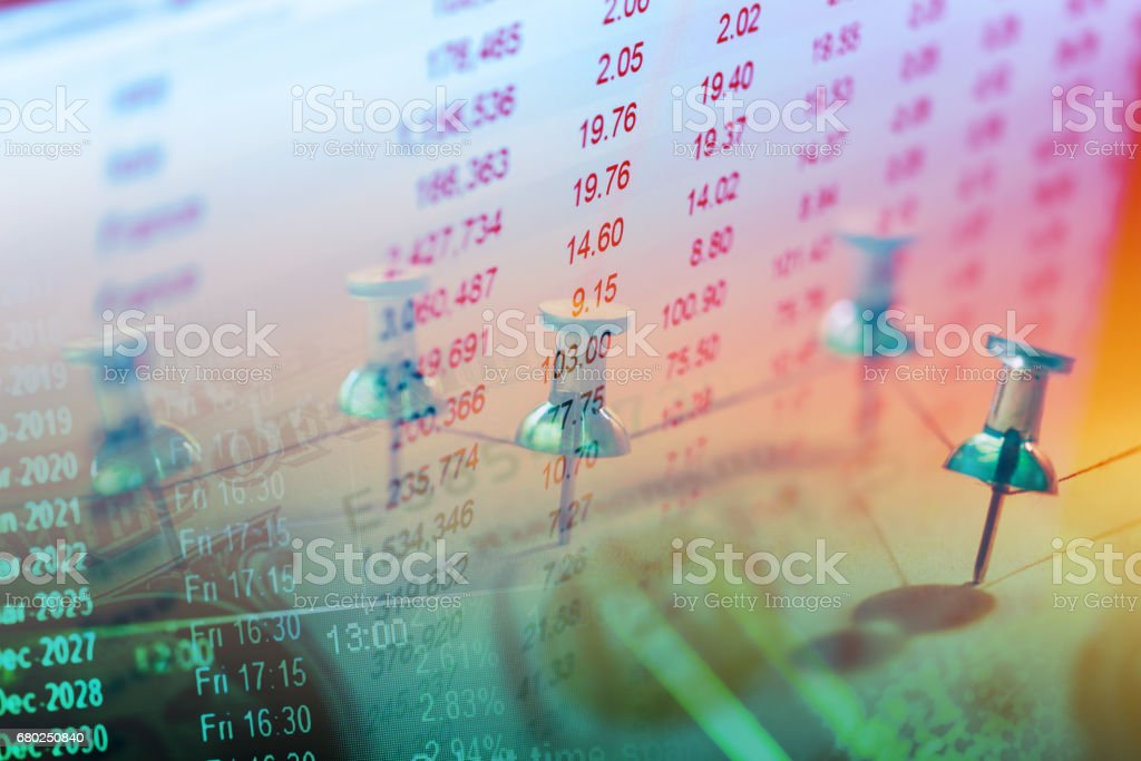 Close up of pin on graph data. stock photo