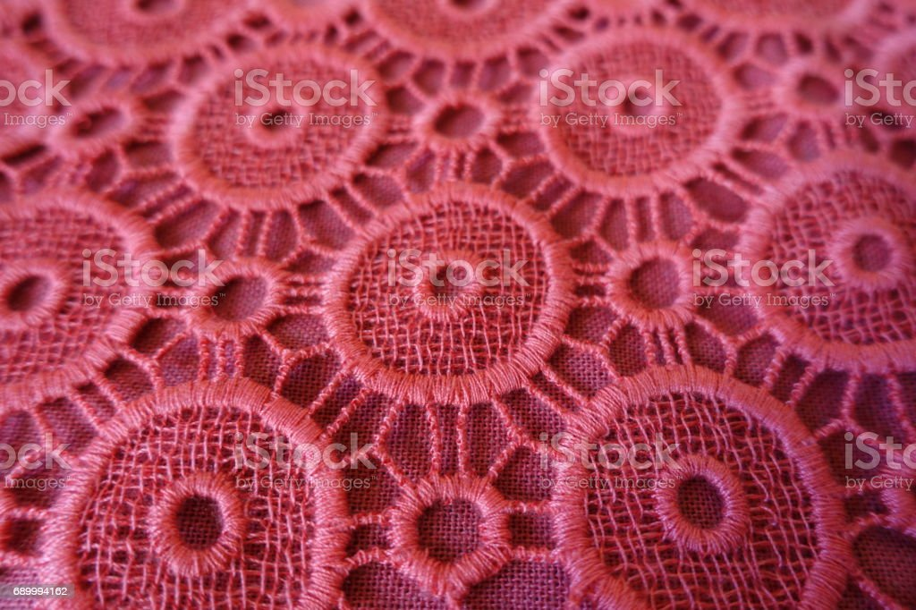 Close up of pink broderie anglaise lace stock photo