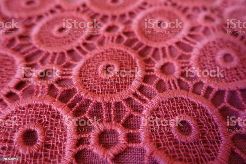 Close up of pink open embroidery with circular eyelets stock photo