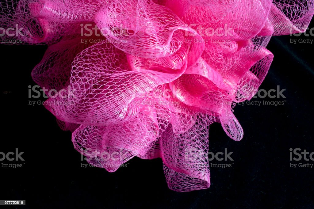 Close Up of Pink Sponge Puff Shower Scrub stock photo