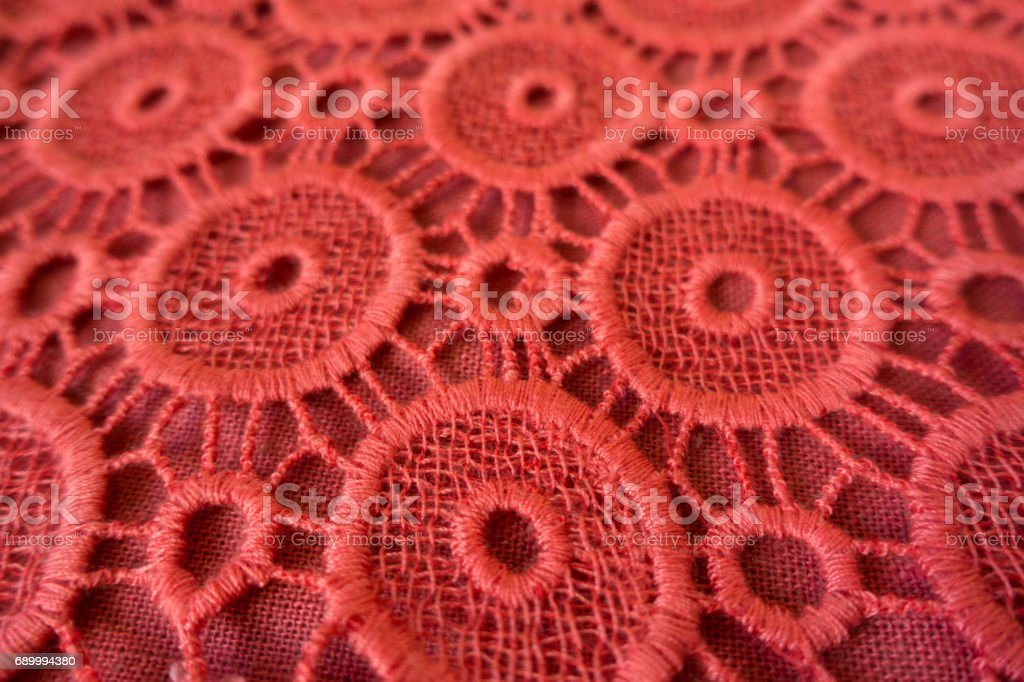 Close up of pinkish orange open embroidery stock photo