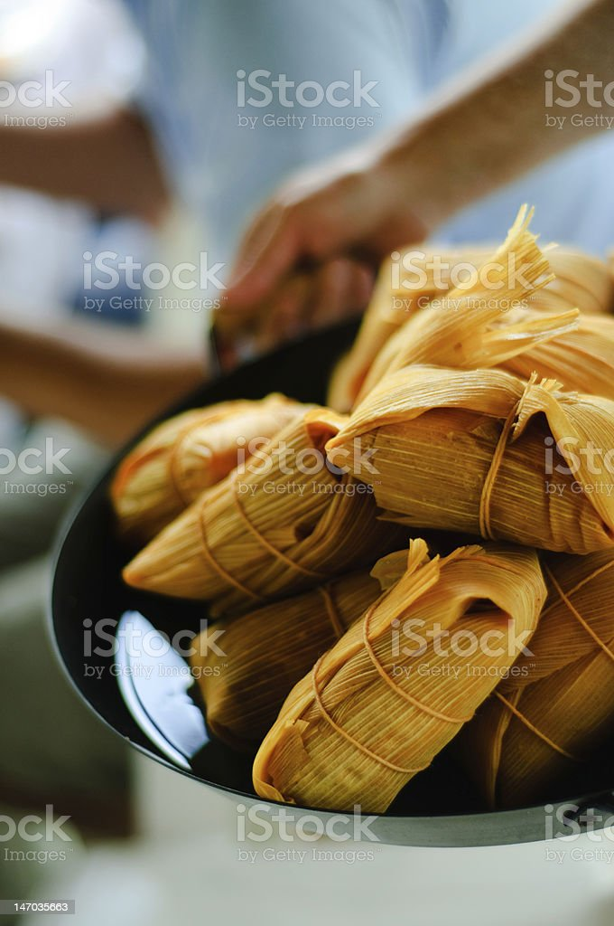 Close Up Of Plated String Wrapped Cooked Tamal stock photo