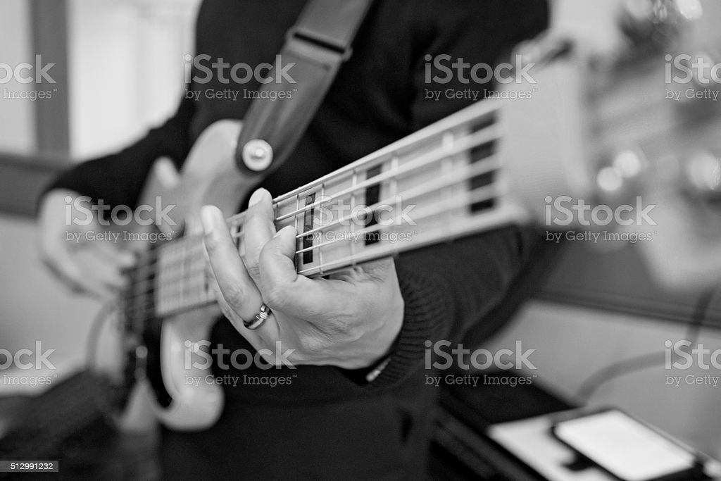 Close up of playing guitar, black and white stock photo