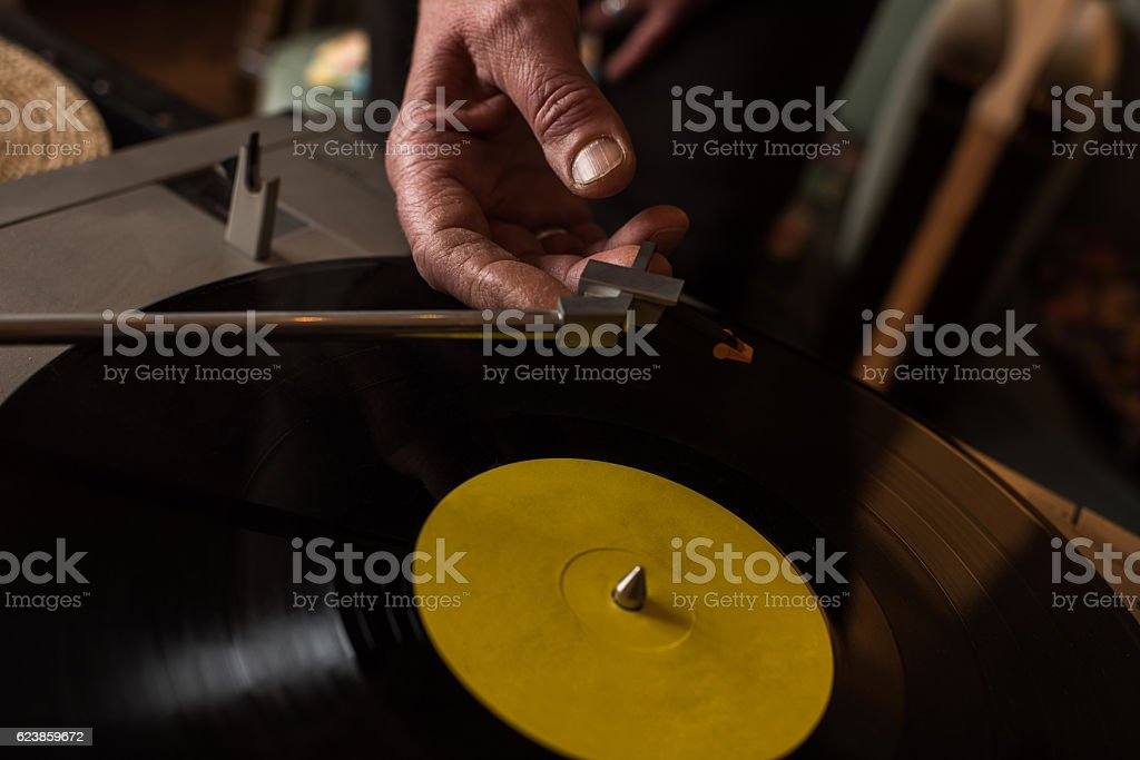 Close up of playing music on a turntable. stock photo