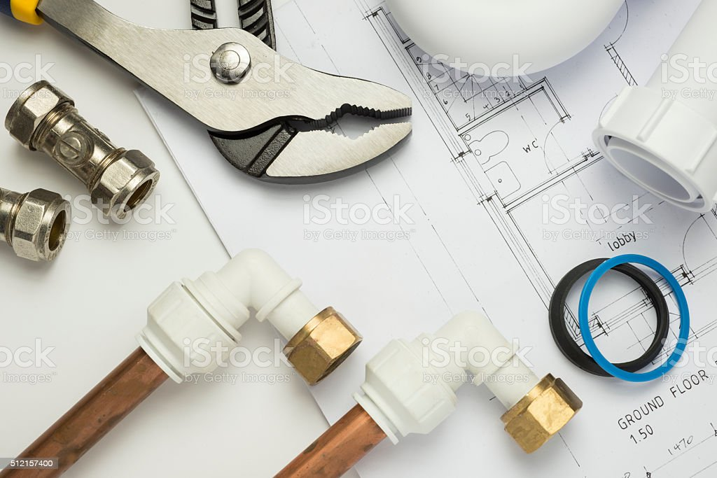 Close up of plumbing paraphernalia on house blueprint stock photo
