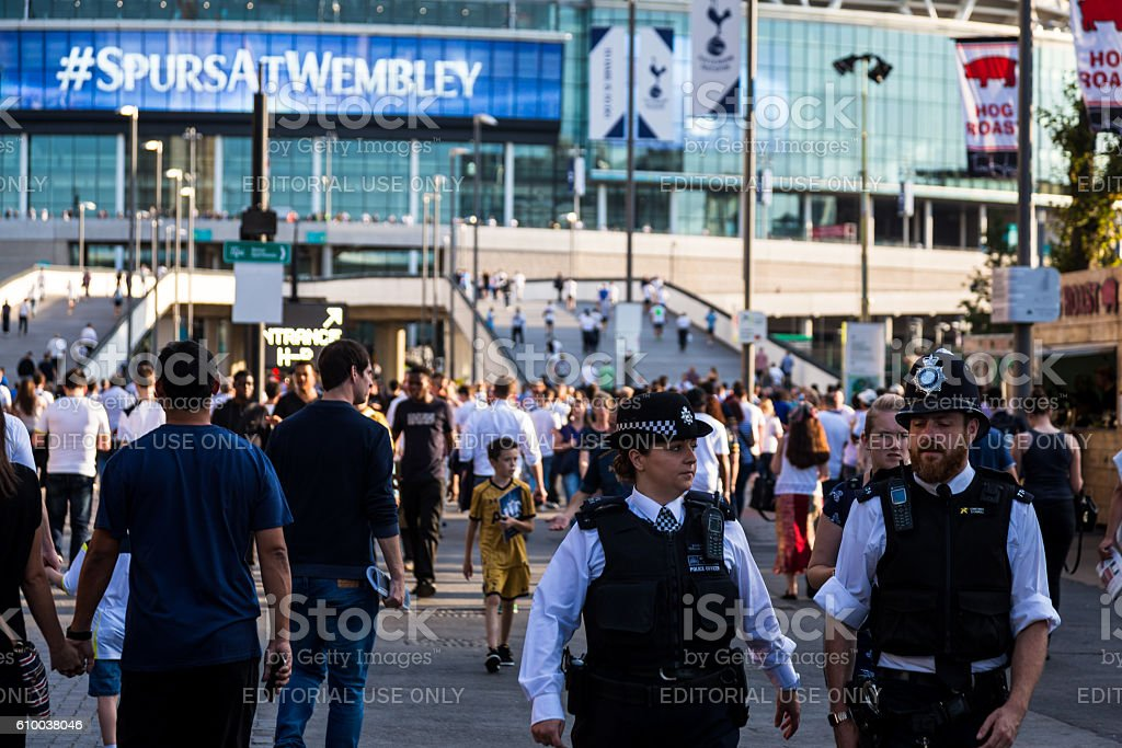 Close up of police and supporters outside Wembley Stadium, London stock photo