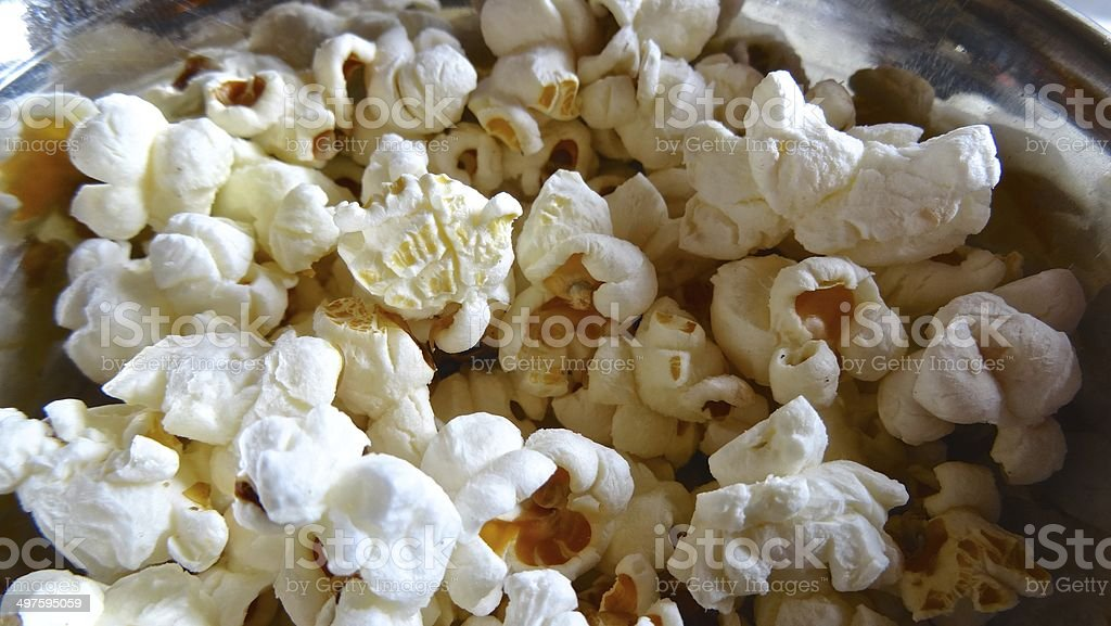 Close up of popcorn on a shiny plate royalty-free stock photo
