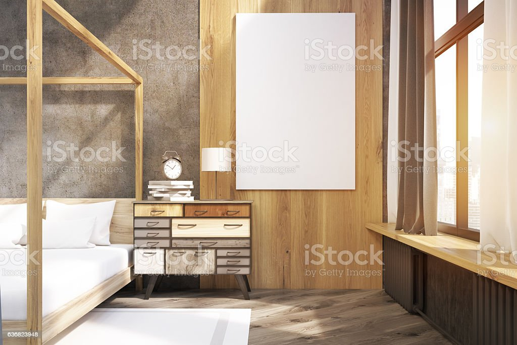Close up of poster in bedroom with pillared bed, toned stock photo