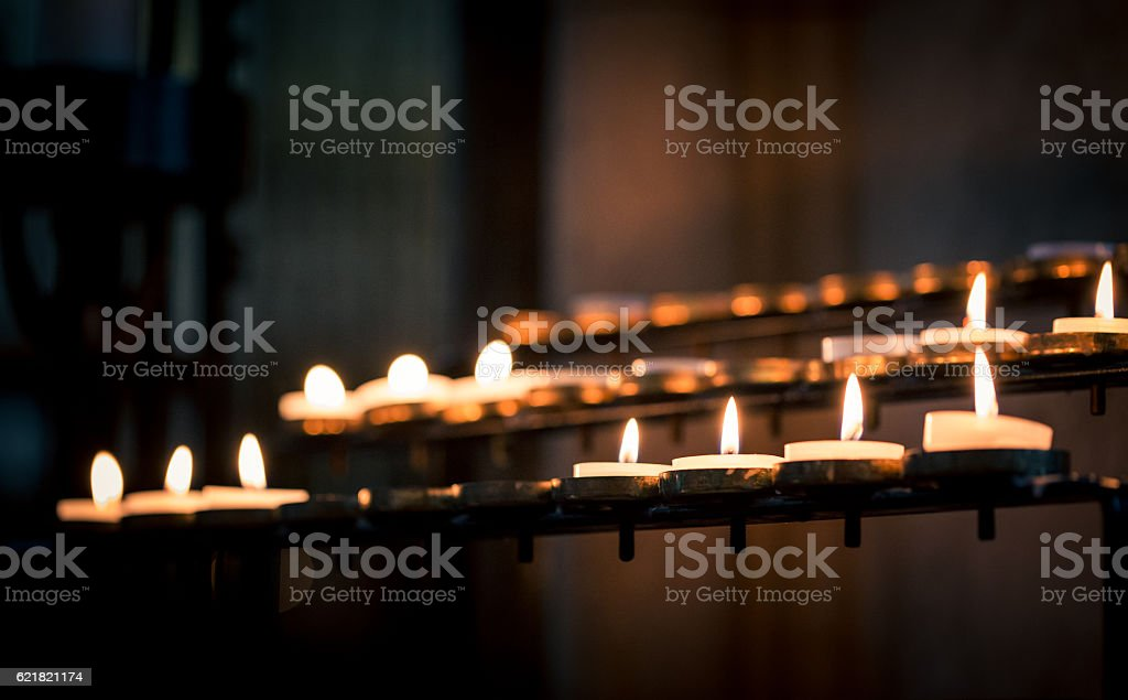 Close up of Prayer Candles in a row in Church stock photo