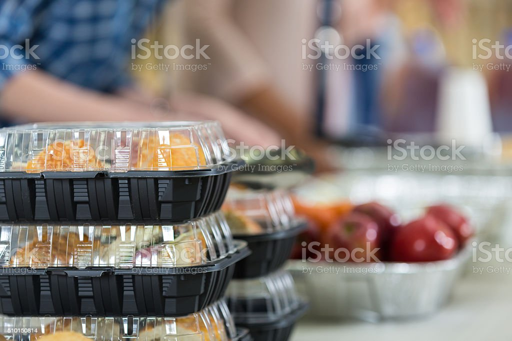 Close up of prepacked food and fruit in soup kitchen stock photo