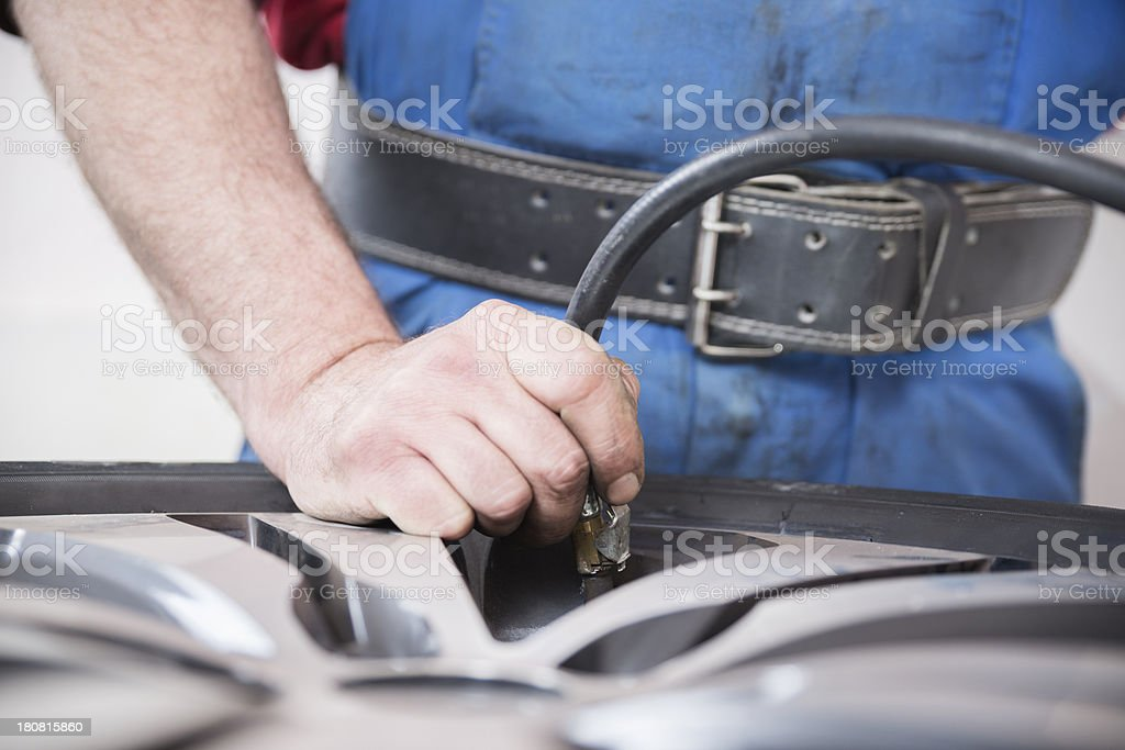 Close up of pumping air to a tire royalty-free stock photo