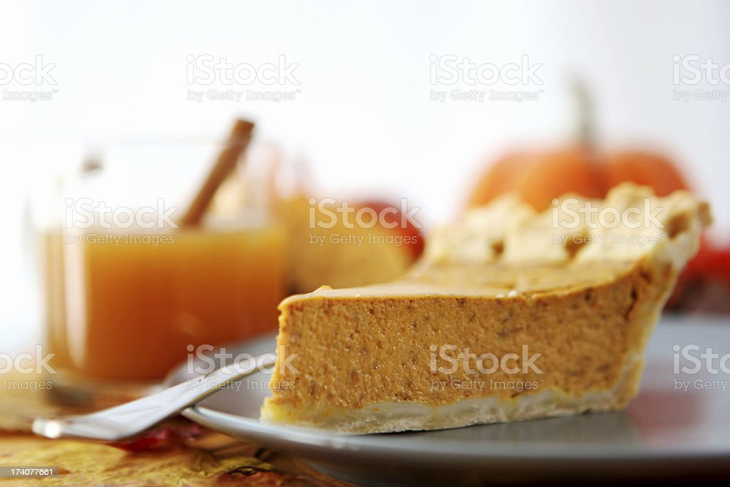 Close up of pumpkin pie with juice in the background stock photo