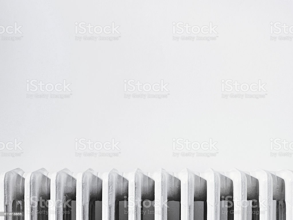 Close up of radiator against white wall stock photo