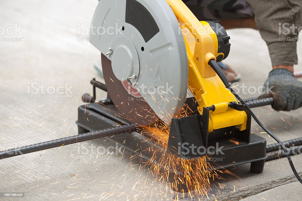 Close up of rebar being cut at a construction site. stock photo