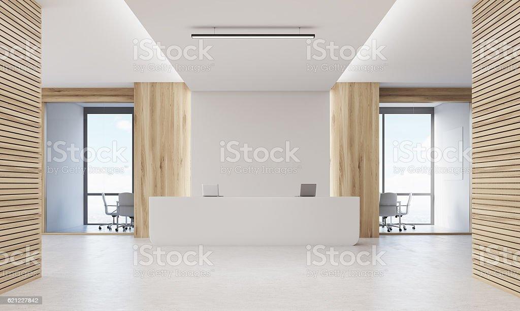 Close up of reception desk in light wood corridor stock photo