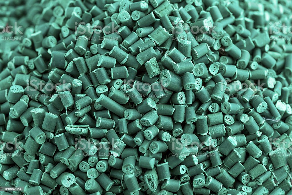 Close up of recycled green polymer granules stock photo