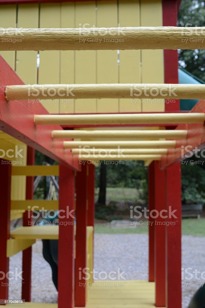 Close up of red and yellow monkey bars. stock photo